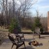 The lovely firepit with 5 patio chairs.  We provide firewood and dry newspaper for easy an fire starting experience!