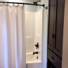 This bathroom has plenty of room for storage.  There will be shampoo, body wash and an ample supply of towels in the linen closet for you. We supply a hairdryer in the drawer. This shower is standard size and is the only shower in the cottage.  The loft does have a half bath.